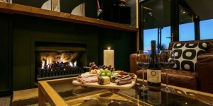 Wine and cheese platter by the fireplace at Te Whau Waiheke