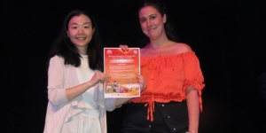 anielle Parker (right), Flight Centre Remuera; was  the winner of two economy tickets with Air New  Zealand to Xi'an via Shanghai, airport transfers,  accommodation, guide, and entrance fees on a  Xi'an group tour. She received her prize at the  SkyCity theatre from Vivien Gao, CTS Tours