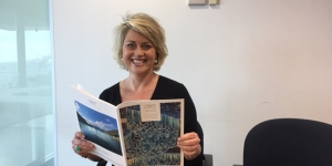 Lisa Pile, with the latest Regent Seven Seas Cruises brochure